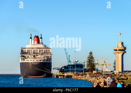 Adelaide, Australia - February 16, 2018: Cunard Line RMS Queen Mary 2 with people on board ready for departure for a cruise from Outer Harbour in Port - Stock Photo