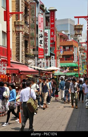 KOBE, JAPAN - APRIL 24, 2012: People visit Chinatown in Kobe, Japan. Nankinmachi, Kobe's Chinatown is the 2nd largest in Japan and a popular tourism a - Stock Photo