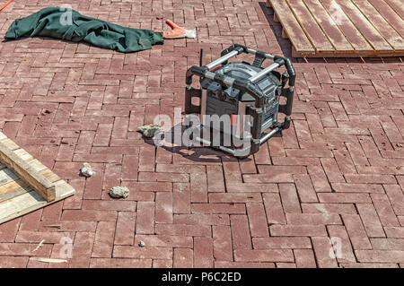 ghetto blaster on the street surrounded by wooden pallets - Stock Photo