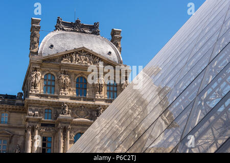 Paris, France - 23 June 2018: Louvre museum and Louvre Pyramid in summertime - Stock Photo