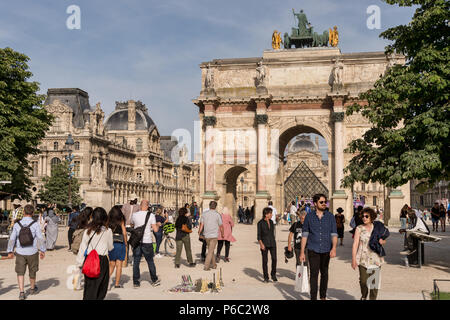 Paris, France - 24 June 2018: Carrousel Arc de Triomphe, Louvre Museum and Pyramid - Stock Photo