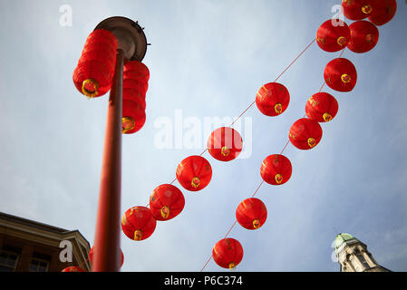 Red Chinese lanterns decorating the streets of China Town in the city centre of London - Stock Photo