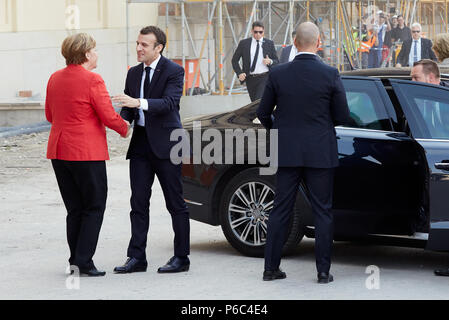Berlin, Germany - Chancellor Angela Merkel welcomes French President Emmanuel Macron at the construction site of the Humboldt Forum. - Stock Photo