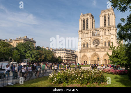 Paris, France - 24 June 2018: Tourists visiting Notre-Dame Cathedrale. - Stock Photo
