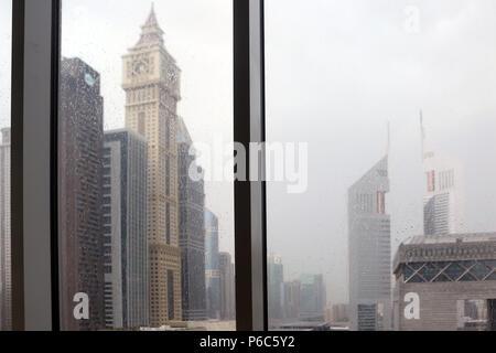 Dubai, United Arab Emirates, Rain on a windowpane in the Financial Center - Stock Photo