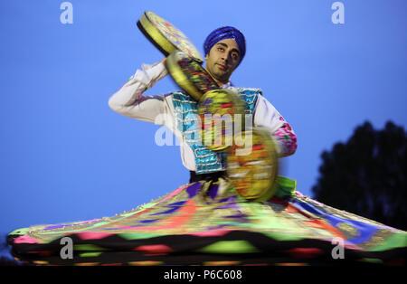 24.03.2017, Dubai, United Arab Emirates, oriental folklore dancer shows a rotating dance - Stock Photo