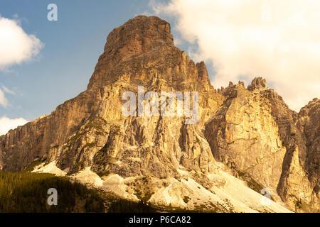 The sun hits the Sassongher mountain Dolomites Corvara in Badia Colfosco Trentino Alto Adige Italy - Stock Photo