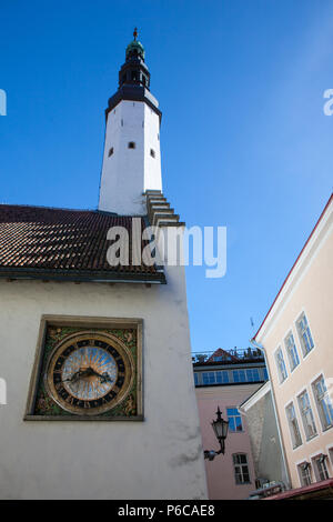 The white tower and old clock in the wall in old town of Tallinn Estonia Europe - Stock Photo