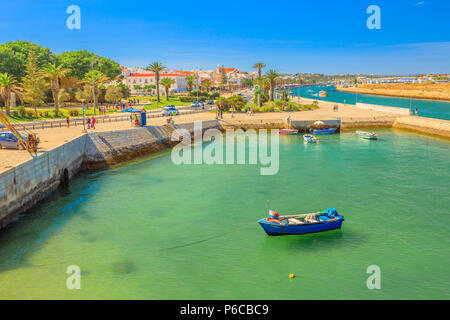 Lagos, Portugal - August 19, 2017: aerial view from the top of the Ponta da Bandeira Fort of Lagos cityscape and harbor in Lagos town. Lagos is a seaside tourist resort on the Algarve coast. - Stock Photo