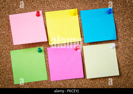 Six Blank sticky notes on a wooden Bulletin Board for your text or message. - Stock Photo