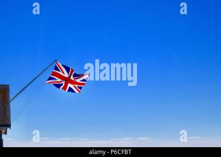 Union jack / flag flying from Southwold pier. June 2018. - Stock Photo