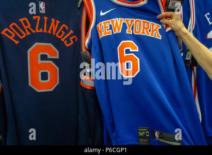 new product 88a26 929a9 New York Knicks basketball apparel in a sporting goods store ...