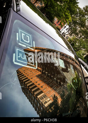 A livery with affiliation stickers for both competing Juno and Uber ride-sharing services in New York on Tuesday, June 26, 2018.(© Richard B. Levine) - Stock Photo