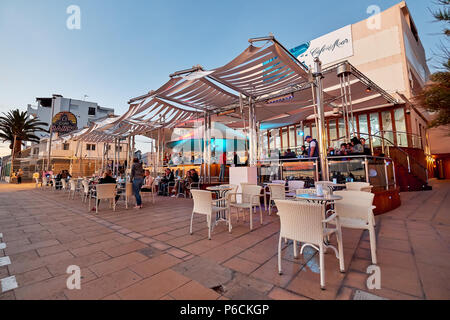 Ibiza Island, Spain - May 1, 2018: People at Cafe Del Mar cafe at sunset. This place is famous for views to the sunsets and lounge music. Ibiza, Balea - Stock Photo