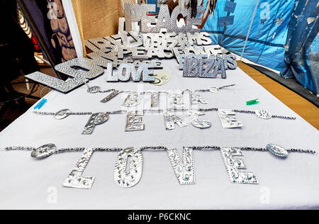 Ibiza Island, Spain - May 2, 2018: Decorative handmade silver words - Ibiza, Love and Peace at the Hippy market. Hippy market organised since the 1970 - Stock Photo