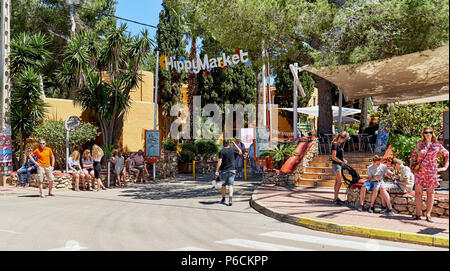 Ibiza Island, Spain - May 2, 2018: People near the entrance of the Hippy market. This market is stuffed full of items from all over the world – many h - Stock Photo