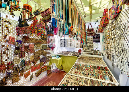 Ibiza Island, Spain - May 2, 2018: Stall full of a handmade fashion accessories, silver jewellery with precious gems and bohemian style of bags in the - Stock Photo