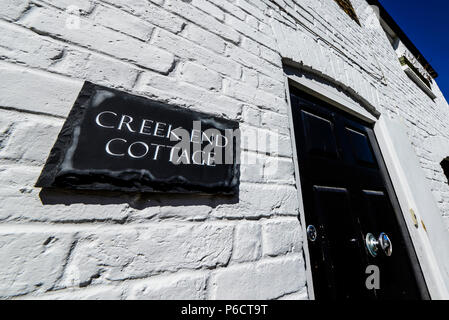 Creek End Cottage, Old Leigh, Leigh on Sea, Southend, Essex, UK. Quaint little home. Bright white with black door. High contrast. Whitewashed property - Stock Photo