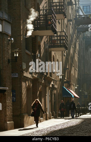 Early morning light in Shad Thames the Running from Tower Bridge street behind the converted ware houses of Butlers Wharf. Bermonsey, London. - Stock Photo