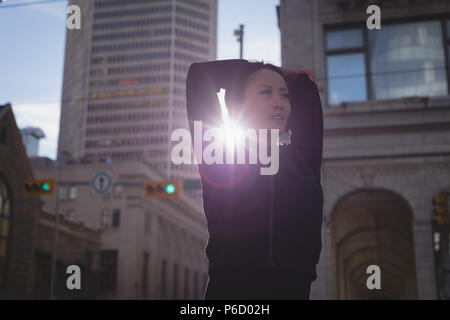 Fit woman warming up at street - Stock Photo