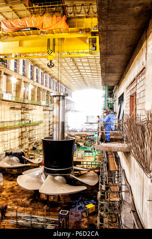 Part of a water turbine in the interior of the Power House of Estreito Hydroelectric Power Plant under construction. Estreito, Maranhao, Brazil. - Stock Photo