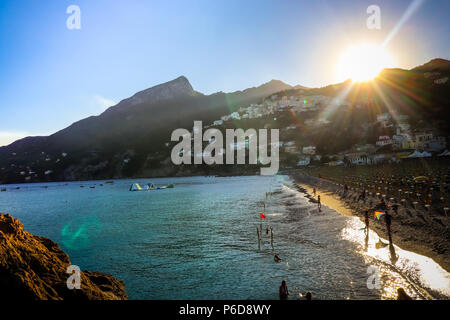 Vietri sul Mare summer beach view sundown over mountains with people and colorful kite near Tyhrrenian sea. Amalfi coast. South of Italy - Stock Photo