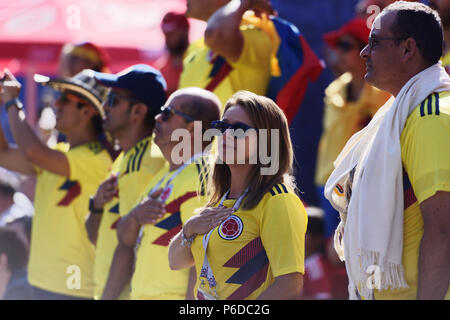 St. Petersburg, Russia - June 28, 2018: Colombian football fans singing the national anthem at FIFA Fan Fest in Saint Petersburg during the FIFA World - Stock Photo