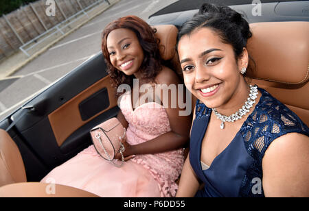 Female pupils dressed in their finery arriving in a limo for their School Prom, Farnham, Surrey, UK. 22 June 2018. - Stock Photo