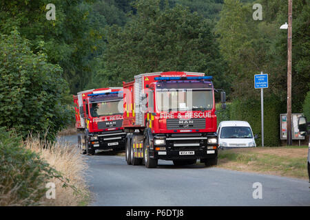 2 Fire and rescue vehicles parked on a narrow road next to a not suitable for hgv vehicles sign at Cwm Rheidol, during the June 2018 Rheidol Valley fire. Credit: Ian Jones/Alamy Live News - Stock Photo