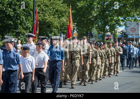 Morden, Surrey, UK. 30 June, 2018. Armed Forces Day Parade takes place at 09.45am with a march past, the salute taken by the Deputy Lieutenant and Mayor of Merton, with dignitaries and local MPs outside Merton Civic Centre on roads closed to traffic. Taking part are members of the Royal British Legion, British Army, Royal Navy, Royal Air Force and London Nepalese (Gurkha) Association. Credit: Malcolm Park/Alamy Live News. - Stock Photo