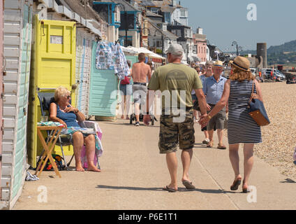 Lyme Regis, Dorset, UK. 30th June 2018. UK Weather: Crowds flock to the beach to enjoy glorious hot sunshine and scorching temperatures at the seaside resort of Lyme Regis.  The UK is set for the hottest day of the year as temperatures hit highs over 30º Celsius this weekend.  Credit: PQ/Alamy Live News - Stock Photo