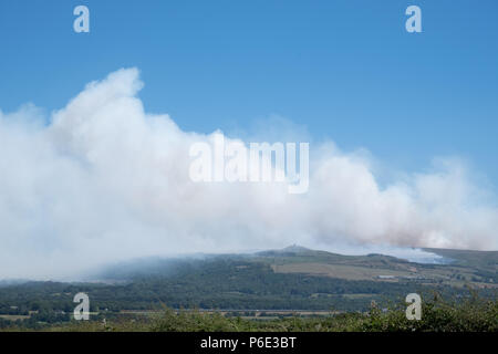 Rivington Pike, UK, 30 June 2018. The extent of the fires and smoke on the west side of the West Pennine Moors around Winter Hill and Rivington Pike can be clearly seen on these distant shots from near Blackrod.Saturday 30/6/18 after at least three days of burning  during a record breaking period of hot, dry, sunny weather.The smoke is travelling over the towns of Chorley,Horwich and Bolton. Credit: Ruaux/Alamy Live News - Stock Photo