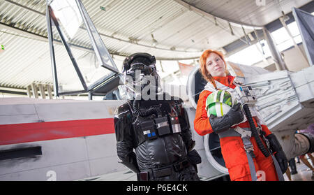 Stuttgart, Germany. 30th June, 2018. Two cosplayers wearing the outfits of the Star Wars characters Tie-Fighter- (L) and X-Wing pilot (R), during the first day of the pop culture fair 'Comic Con Germany' at the Stuttgart trade fair. The fair is taking place from 30 June to 01 July. Credit: Sebastian Gollnow/dpa/Alamy Live News - Stock Photo