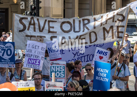 London, UK. 30 June, 2018. A large banner amongst the placards reads ' Save our NHS, It saved me'. With the NHS 70 years old this year, thousands marched through central London in a National rally to show support for the service and to demand more funding from the Government. David Rowe/Alamy Live News - Stock Photo