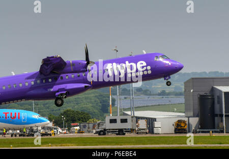 ATR 72 turboprop short haul airliner operated by Flybe taking off at Cardiff Wales Airport - Stock Photo