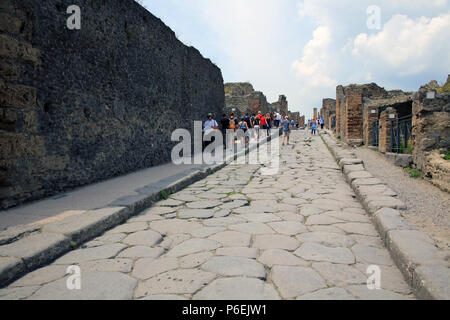 ancient roman road in the recovered ruins of Pompeii after the eruption of vesuvius in AD 79 - Stock Photo