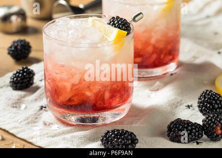 Alcoholic Blackberry Gin Bramble Cocktail with Lemon - Stock Photo
