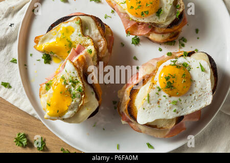 Homemade French Croque Madame Sandwich with Ham and Cheese - Stock Photo