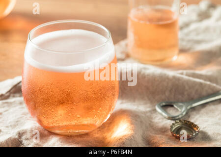 Alcoholic Sparkling Rose Cider in a Glass - Stock Photo