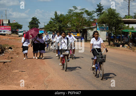 Thakhek, Laos - November 05, 2014: Midddle school Laos students in the uniform are heading back home from school in the rural area of Thakhek, Laos - Stock Photo