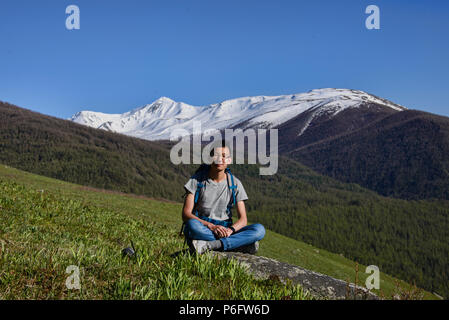 Enjoying the view, Kanas Lake National Park, Xinjiang, China - Stock Photo