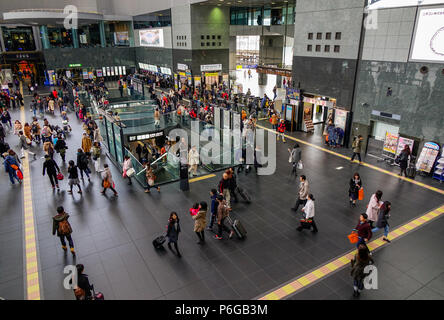 Kyoto, Japan - Dec 25, 2016. Crowd of people at passenger concourse inside Kyoto Station building. - Stock Photo