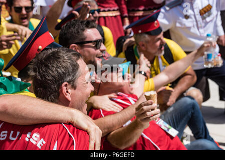 ROSTOV-ON-DON, RUSSIA - JUNE 17, 2018: Swiss fans enjoy cossack show at the airport - Stock Photo