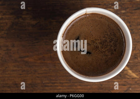coffee to go in a disposable cup on a white background, place for text. top view - Stock Photo