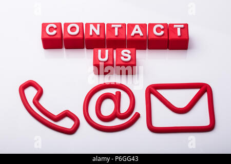 Red Cubes With Contact Us Text And Icons Showing Various Communication Options - Stock Photo