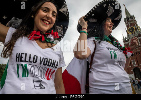 Mexican women in a sombrero with an inscription on T-shirts 'Hello vodka I am tequila' are walking along Red Square in Moscow during the World Cup - Stock Photo