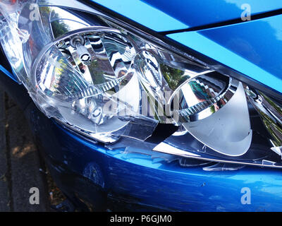Car front view close up photographs of a Peugeot 208 that was dammaged in a car crash leading to front end damage on this car - Stock Photo