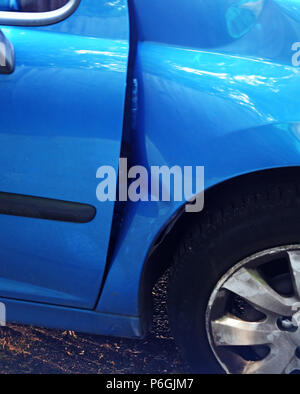 close up photographs of a Peugeot 208 that was dammaged in a car crash leading to front end damage on this car - Stock Photo