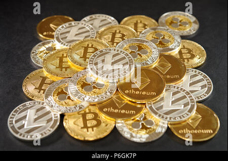 Big pyramid from real cryptocurrency coins. Bitcoins, litecoins, etherum, ripple - Stock Photo