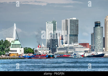 Rotterdam, The Netherlands, May 31, 2018: Cruiseships, cargo vessels and a tourist boat on the Nieuwe Maas river between downtown and the southbank - Stock Photo